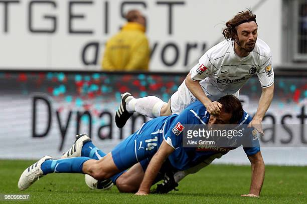 Josip Simunic of Hoffenheim is challenged by Jonathan Jaeger of Freiburg during the Bundesliga match between 1899 Hoffenheim and SC Freiburg at the...