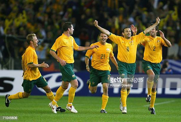 Josip Skoko of Australia celebrates with teammates after scoring during the Powerade Cup international friendly match between Australia and Greece at...