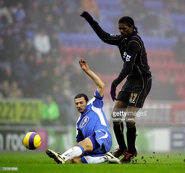 Josip Soko of Wigan tackles Kanu of Portsmouth during the Barclays Premiership match between Wigan Athletic and Portsmouth at the JJB Stadium on...