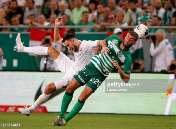 Josip Tadic of FK Suduva battles for the ball in the air with Miha Blazic of Ferencvarosi TC during the UEFA Europa League Play-off Second Leg match...