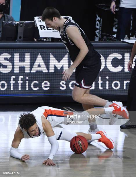 Josip Vrankic of the Santa Clara Broncos fouls Colbey Ross of the Pepperdine Waves during the West Coast Conference basketball tournament...