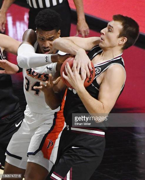 Josip Vrankic of the Santa Clara Broncos grabs a rebound against Victor Ohia Obioha of the Pepperdine Waves during the West Coast Conference...