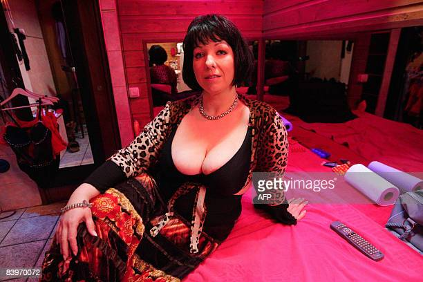 Josje who has worked for 20 years as a prostitute in Amsterdam poses in her room in the red light district of Amsterdam on December 8 2008 Under a...