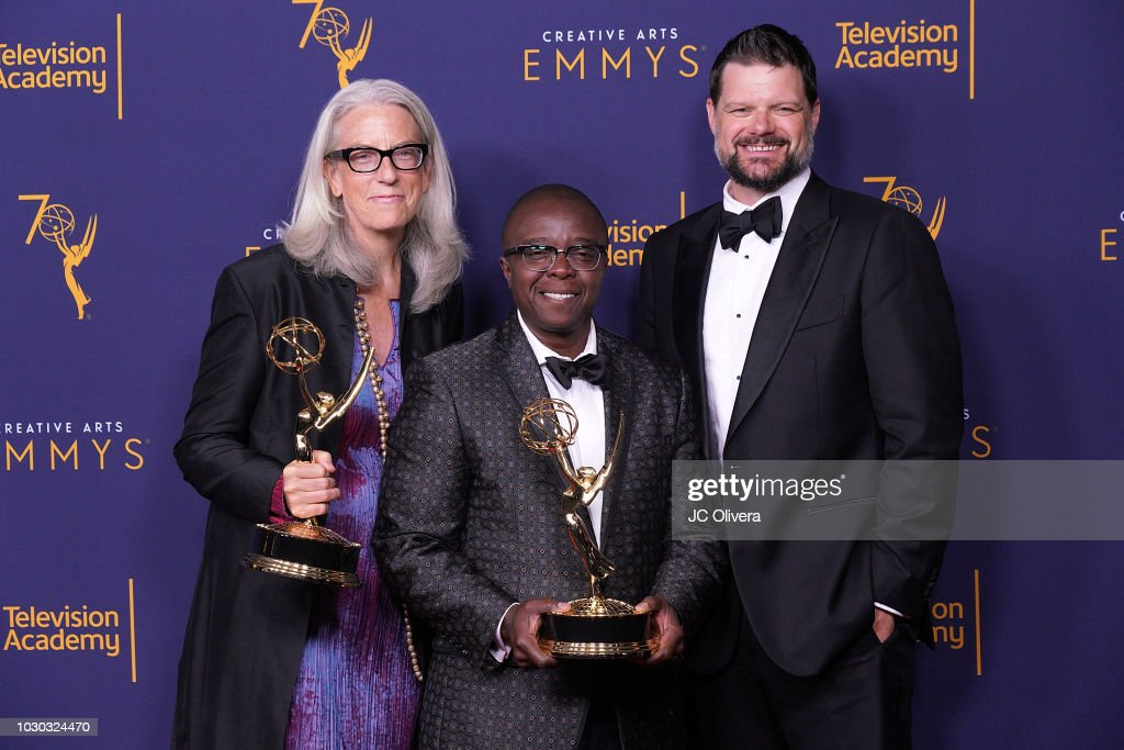 Joslyn Barnes, Yance Ford, and Alan Jacobsen, winners of the award for exceptional merit in documentary filmmaking for 'Strong Island' pose in the press room during the 2018 Creative Arts Emmy Awards at Microsoft Theater on September 9, 2018 in Los Angeles, California.