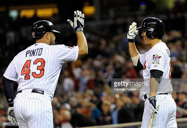 Josmil Pinto of the Minnesota Twins celebrates after hitting a home run against the Kansas City Royals with teammate Kurt Suzuki during the fourth...
