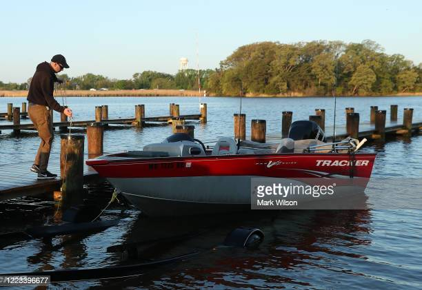 Jospeh O'Conner launches his boat at Sandy Point State Park on May 7 2020 in Annapolis Maryland Governor Larry Hogan has relaxed the ban on outdoor...