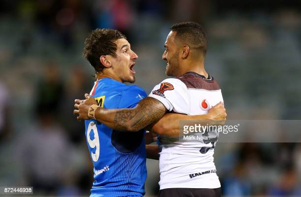 Jospeh Tramontana of Italy and Apisai Koroisau of Fiji embrace after the 2017 Rugby League World Cup match between Fiji and Italy at Canberra Stadium...
