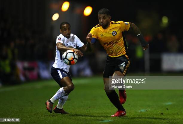 Joss Labadie of Newport County is challenged by Kyle WalkerPeters of Tottenham Hotspur during The Emirates FA Cup Fourth Round match between Newport...