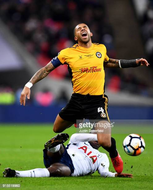 Joss Labadie of Newport County is tackled by Victor Wanyama of Tottenham Hotspur during The Emirates FA Cup Fourth Round Replay between Tottenham...