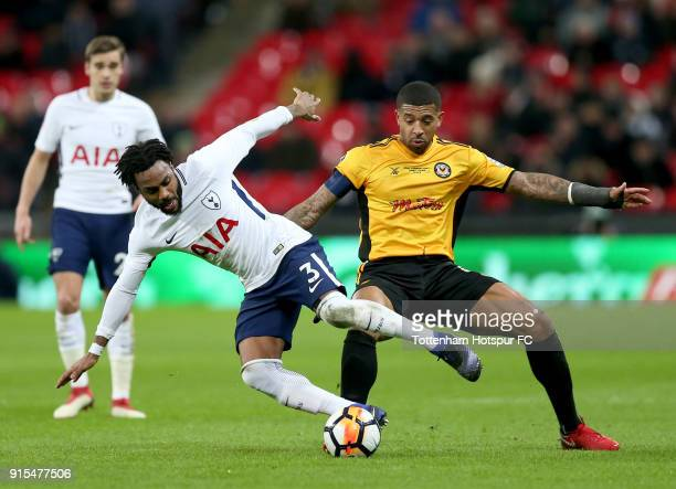 Joss Labadie of Newport County tackles Victor Wanyama of Tottenham Hotspur during The Emirates FA Cup Fourth Round Replay match between Tottenham...
