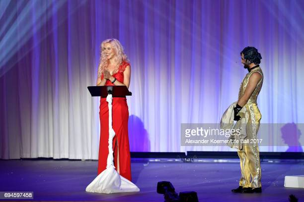 Joss Stone and Conchita Wurst perform on stage during the Life Ball 2017 show at City Hall on June 10 2017 in Vienna Austria