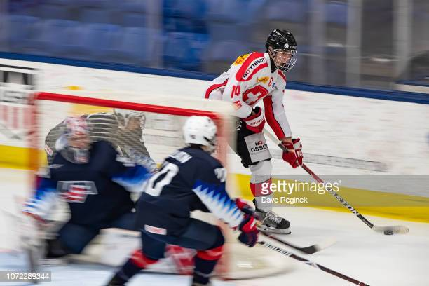 Josselin Dufey of the Switzerland Nationals skates around the net with the puck against the USA Nationals during day2 of game two of the 2018 Under17...