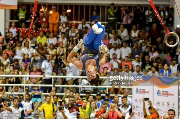 Jossimar Calvo of Colombia competes on the rings during the men's individual allaround final of the Artistic Gymnastics of the XVIII Juegos...