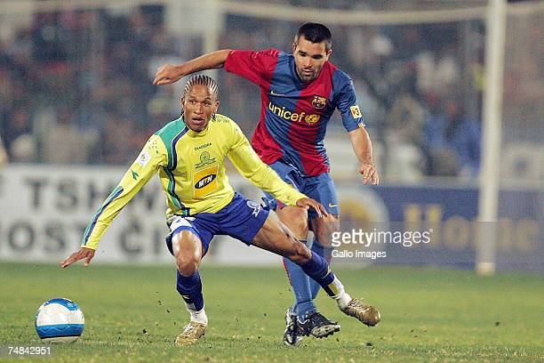 Josta Dladla of Sundowns and Deco of FC Barcelona in action during the PSL soccer match between the Sundowns and FC Barcelona at Loftus Versfeld...