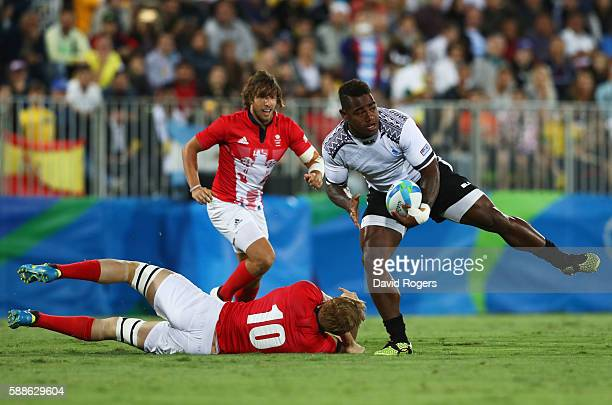 Josua Tuisova of Fiji beats Sam Cross of Great Britain during the Men's Rugby Sevens Gold medal final match between Fiji and Great Britain on Day 6...