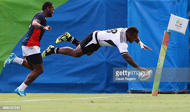 Josua Tuisova of Fiji dives to score a try during the Men's Rugby Sevens semi final match between Fiji and Japan on Day 6 of the Rio 2016 Olympics at...