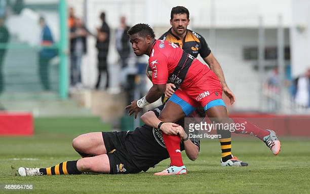 Josua Tuisova of Toulon is tackled by Andrea Masi during the European Rugby Champions Cup quarter final match between RC Toulon and Wasps at the...