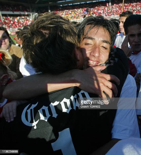 Josue Castillejos of Toluca embraces his goal keeper Hernan Cristante after winning the Championship of the Torneo Apertura in Mexico 21 December...