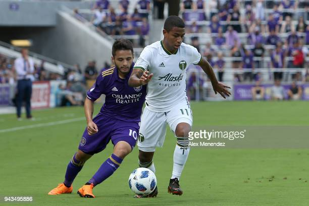 Josue Colman of Orlando City SC an Andy Polo of Portland Timbers chase the ball during an MLS soccer match at Orlando City Stadium on April 8 2018 in...