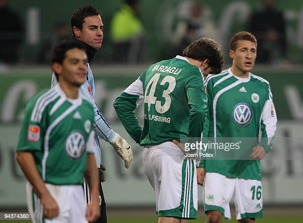 Josue Diego Benaglio Andrea Barzagli and Fabian Johnson of Wolfsburg look dejected during the Bundesliga match between VfL Wolfsburg and Borussia...