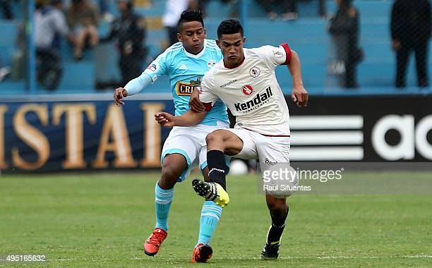 Josue Estrada of Sporting Cristal struggles for the ball with Anderson Santamaria of Leon de Huanuco during a match between Sporting Cristal and Leon...