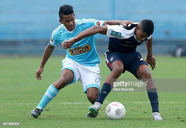 Josue Estrada of Sporting Cristal struggles for the ball with Wilder Cartagena of San Martin during a match between Sporting Cristal and San Martin...