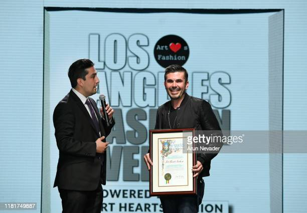 Josue Landa presents on behalf of Council Member Jose Huizar of District 14 and Mayor Eric Garcetti to Erik Rosete and Los Angeles Fashion Week...