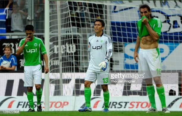Josue, Makoto Hasebe, Sotirios Kyrgiakos look dejected after Roberto Firmino scored his teams third goal match between TSG 1899 Hoffenheim and VFL...