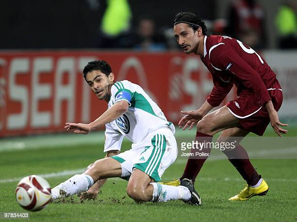 Josue of Wolfsburg and Hasan Kabze of Kazan compete for the ball during the UEFA Europa League round of 16 second leg match between VfL Wolfsburg and...