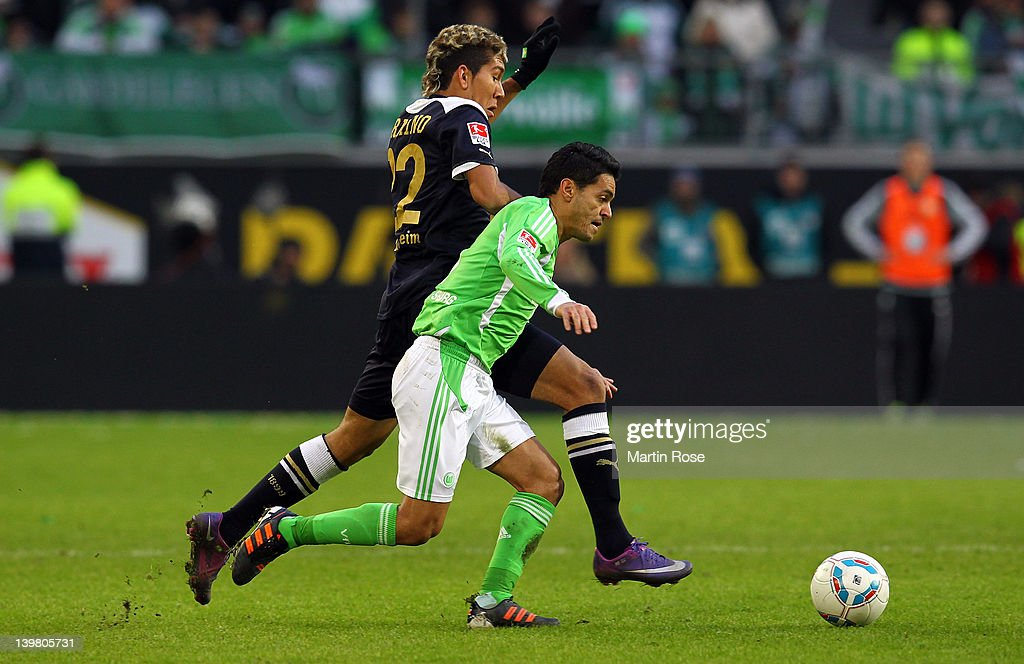 Josue (front) of Wolfsburg and Roberto Firmino (back) of Hoffenheim battle for the ball during the Bundesliga match between VfL Wolfsburg and 1899 Hoffenheim at the Volkswagen Arena on February 25, 2012 in Wolfsburg, Germany.