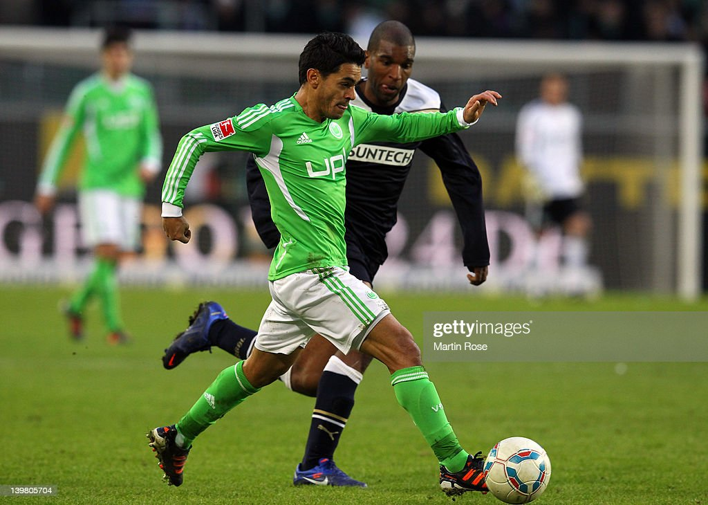 Josue (front) of Wolfsburg and Ryan Babel(back) of Hoffenheim battle for the ball during the Bundesliga match between VfL Wolfsburg and 1899 Hoffenheim at the Volkswagen Arena on February 25, 2012 in Wolfsburg, Germany.