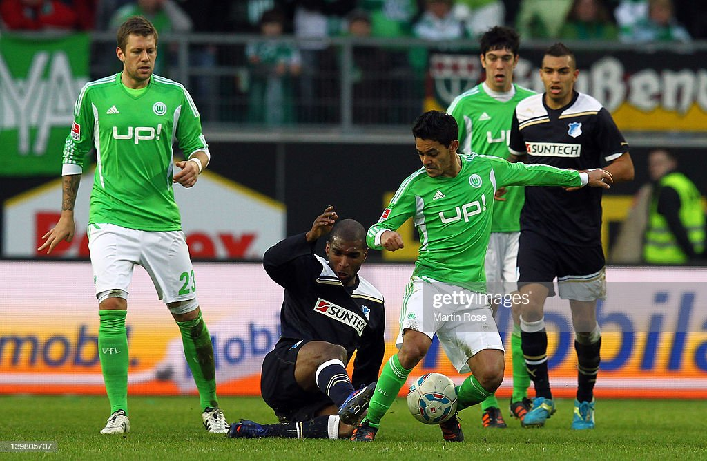 Josue (R) of Wolfsburg and Ryan Babel(L) of Hoffenheim battle for the ball during the Bundesliga match between VfL Wolfsburg and 1899 Hoffenheim at the Volkswagen Arena on February 25, 2012 in Wolfsburg, Germany.