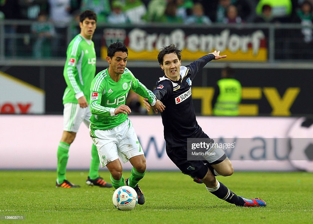 Josue (L) of Wolfsburg and Srdan Lakic (R) of Hoffenheim battle for the ball during the Bundesliga match between VfL Wolfsburg and 1899 Hoffenheim at the Volkswagen Arena on February 25, 2012 in Wolfsburg, Germany.