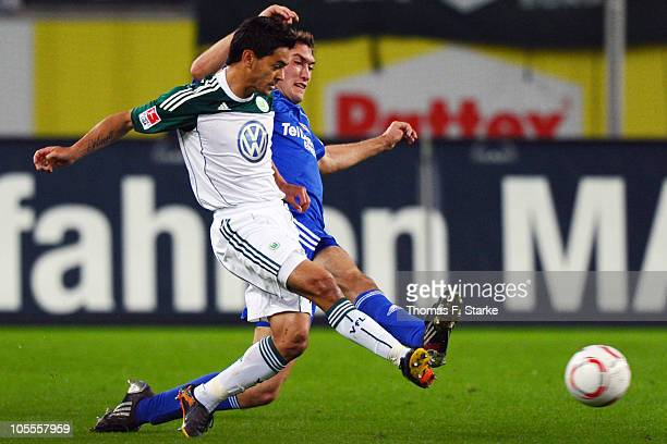 Josue of Wolfsburg and Stefan Reinartz of Leverkusen fight for the ball during the Bundesliga match between VfL Wolfsburg and Bayer Leverkusen at...