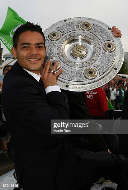 Josue of Wolfsburg celebrate the German championship with the trophy after their Bundesliga match against SV Werder Bremen on May 23 2009 in...