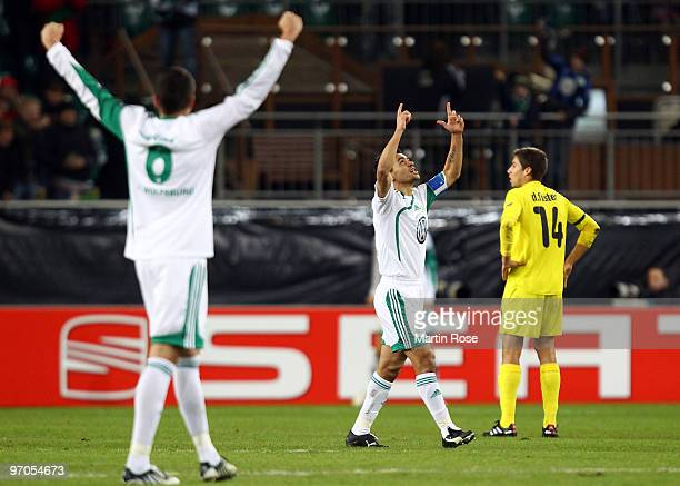 Josue of Wolfsburg celebrates his team's opening goal during the UEFA Europa League knock-out round, second leg match between VfL Wolfsburg and...