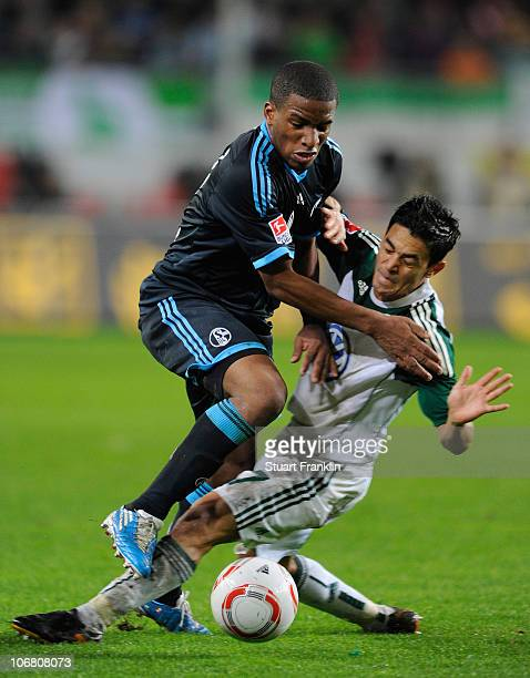 Josue of Wolfsburg challenges Jefferson Farfan of Schalke during the Bundesliga match between VfL Wolfsburg and FC Schalke 04 at Volkswagen Arena on...