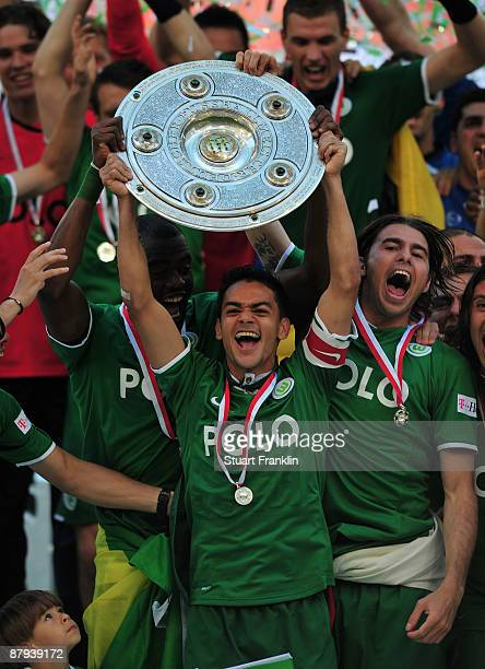 Josue of Wolfsburg lifts the German Championship trophy after the Bundesliga match between VfL Wolfsburg and Werder Bremen at the Volkswagen Arena on...