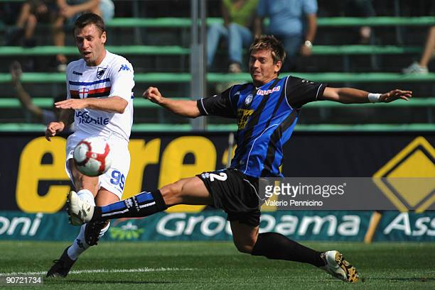 Josue Talamonti of Atalanta BC battles for the ball with Antonio Cassano of UC Sampdoria during the Serie A match between Atalanta BC and UC...