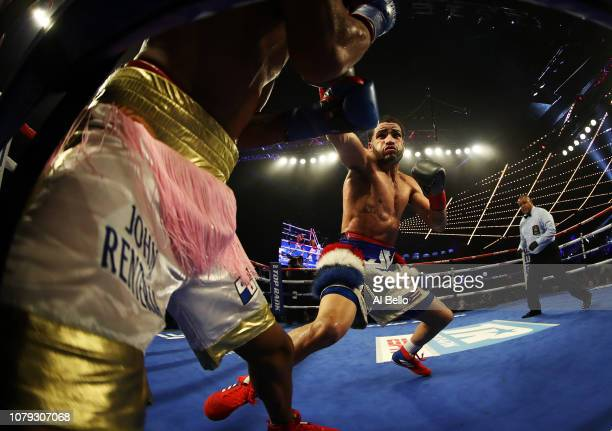 Josue Vargas punches John Renteria during their junior welterweight bout at The Hulu Theater at Madison Square Garden on December 08 2018 in New York...