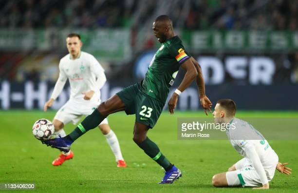 Josuha Guilavogui of VfL Wolfsburg beats Maximilian Eggestein of Werder Bremen during the Bundesliga match between VfL Wolfsburg and SV Werder Bremen...
