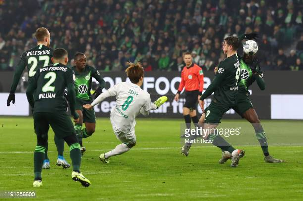 Josuha Guilavogui of VfL Wolfsburg blocks a shot by Yuya Osako of SV Werder Bremen with his hand to concede a penalty following a VAR check during...
