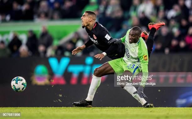 Josuha Guilavogui of VfL Wolfsburg in action with Kevin PrinceBoateng of Eintracht Frankfurt uring the Bundesliga match between VfL Wolfsburg and...