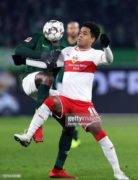 Josuha Guilavogui of Wolfsburg and Daniel Didavi of Stuttgart vie for the ball during the Bundesliga match between VfL Wolfsburg and VfB Stuttgart at...