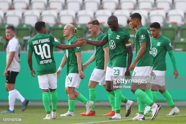 Josuha Guilavogui of Wolfsburg celebrates his team's fourth goal with teammates during the DFB Cup first round match between FSV Union Fürstenwalde...