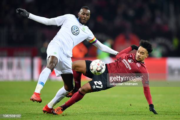 Josuha Guilavogui of Wolfsburg is challenged by Matheus Pereira of Nuernberg during the Bundesliga match between 1 FC Nuernberg and VfL Wolfsburg at...