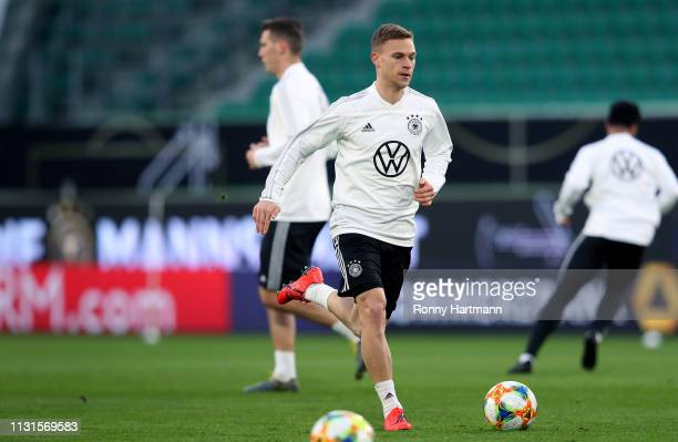 Josuha Kimmich of the German National Team runs with the ball during a training session ahead of their friendly match against Serbia on March 19 2019...