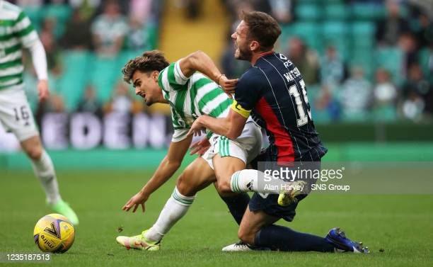 Jota and Keith Watson in action during a cinch Premiership match between Celtic and Ross County at Celtic Park on September 11 in Glasgow, Scotland