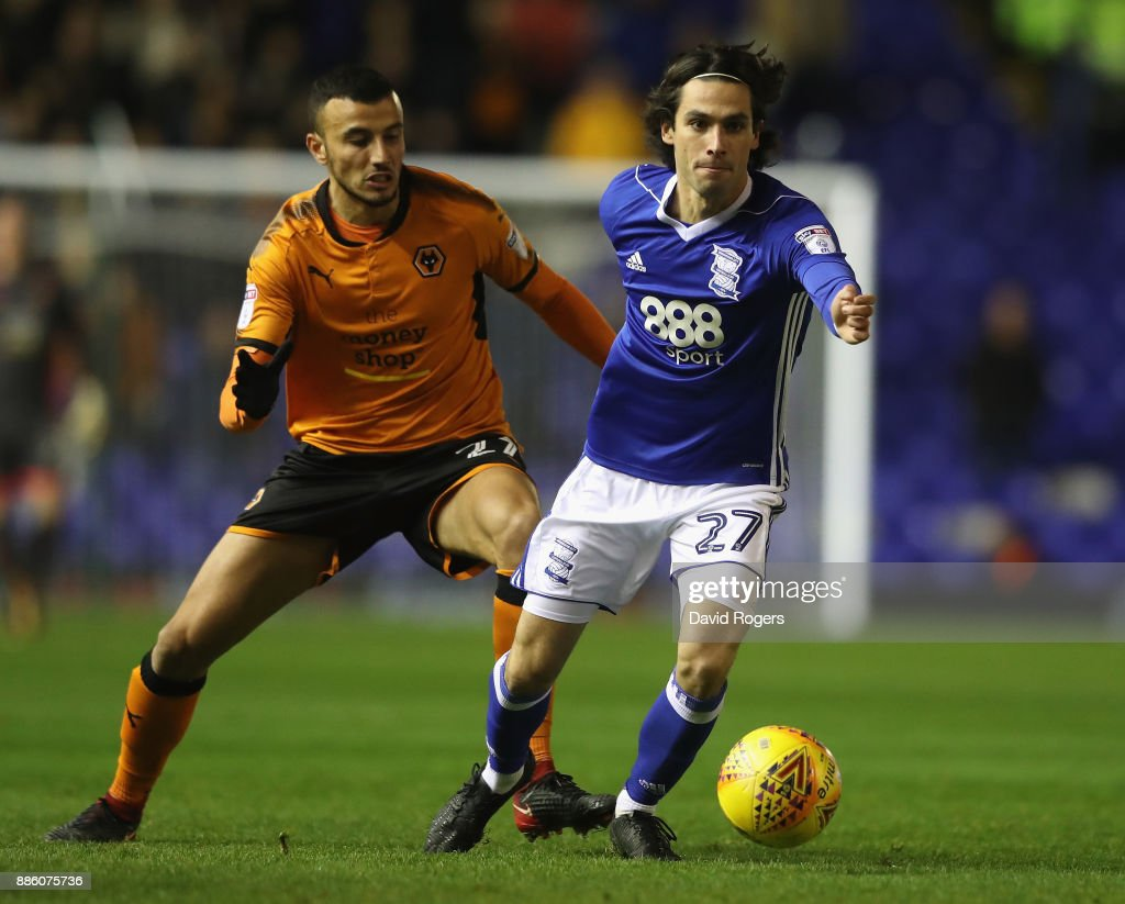 Jota of Birmingham City moves away from Romain Saiss during the Sky Bet Championship match between Birmingham City and Wolverhampton Wanderers at St Andrews on December 4, 2017 in Birmingham, England.