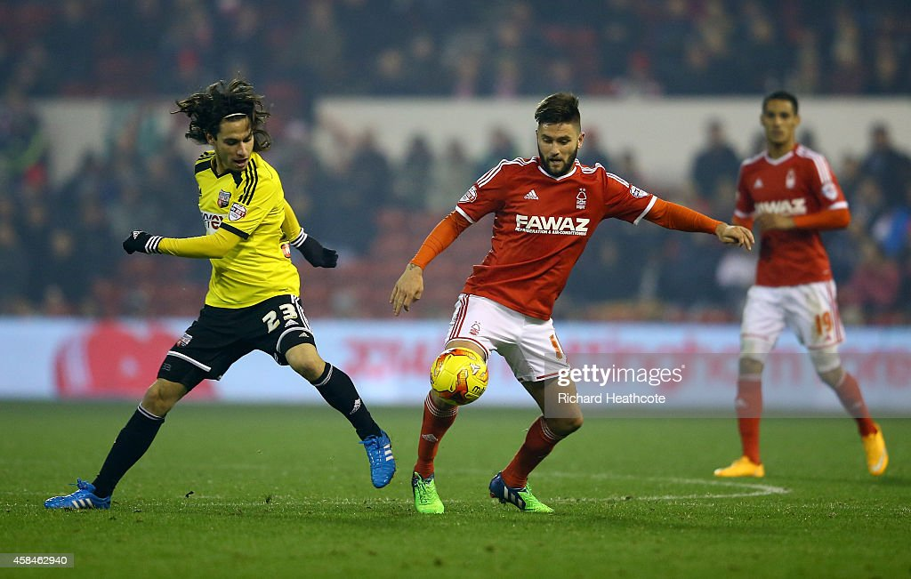 Jota of Brentford battles with Henri Lansbury of Forest during the Sky Bet Championship match between Nottingham Forest and Brentford at the City Ground on November 5, 2014 in Nottingham, England.